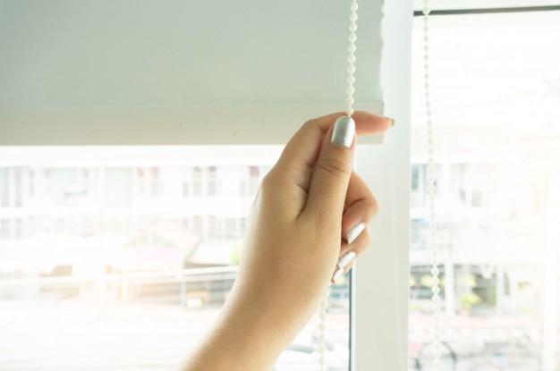 window-curtain-shutter-by-woman-hands-installing-window-blinds-closeup_1715-825